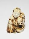 Image of Seated Figure Holding Child or Oni